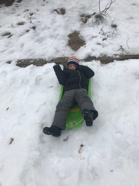 child 2 sledding
